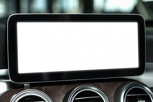 Close-up screen with a white background on the control panel of a modern car. mocap for advertising in the multimedia panel