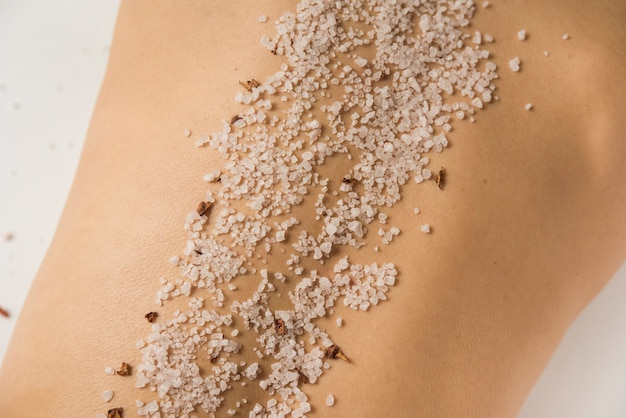 Close-up of sea salt on woman's back in spa