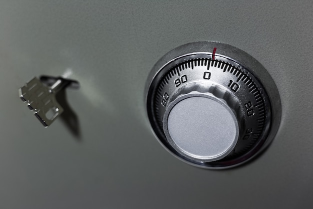 Close-up of security lock and key of safe.