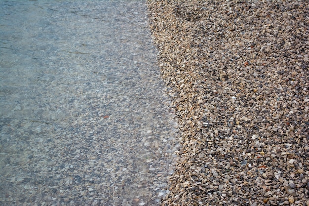 Close up of the see meeting the sand on the beach