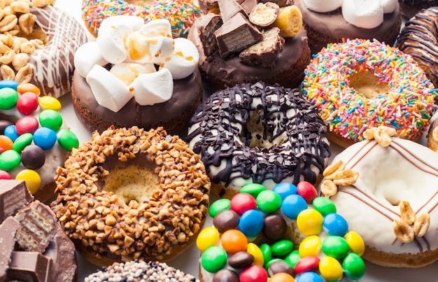 Close up of a selection of colorful donuts.