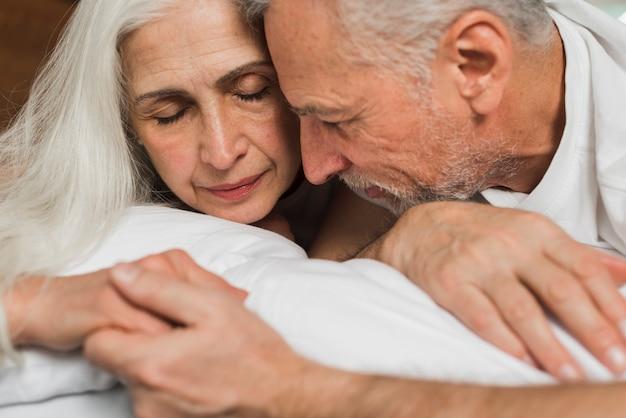 Close-up senior couple holding hands