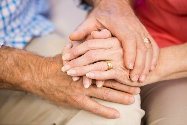 Close up of senior couples hands together