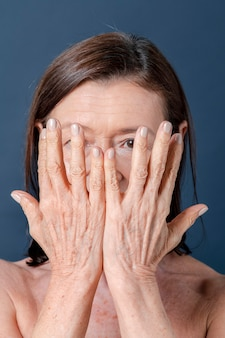 Close up of a senior woman with aging hands