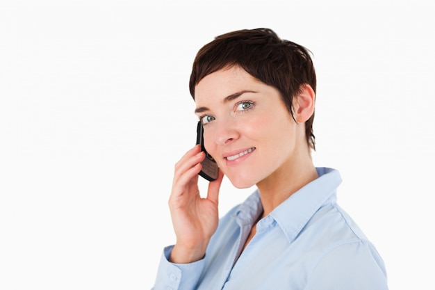Close up of a serious woman on the phone