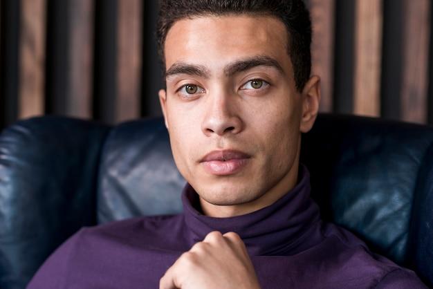Close-up of serious young man looking at camera