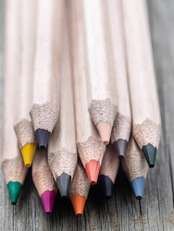 Close-up set of colored pencils for drawing on blurred background.