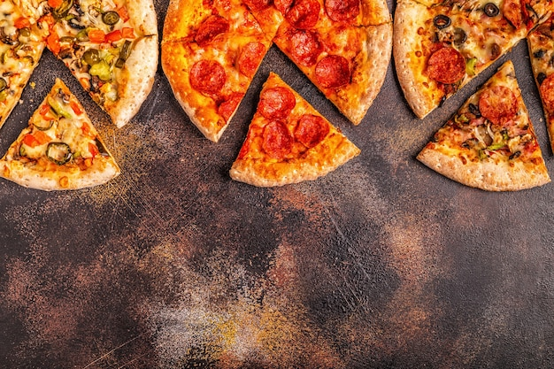 Close up on set of different pizzas