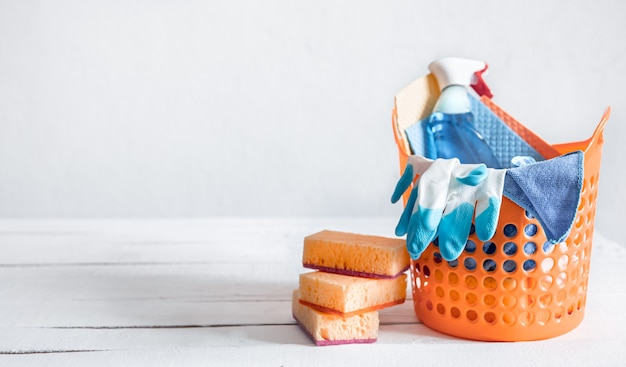 Close up set of home cleaning products in a bright basket. means for maintaining cleanliness  background