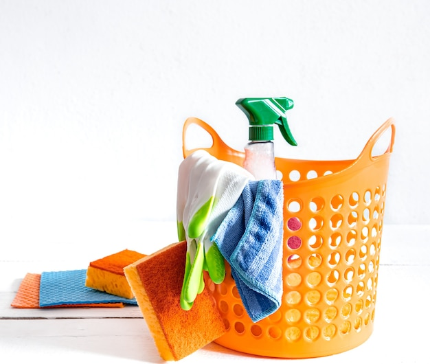 Close up set of home cleaning products in a bright basket