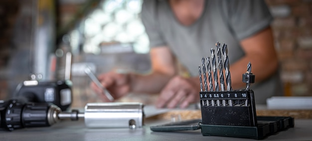 Close up of a set of wood drills on a work table of a joiner in a workshop.