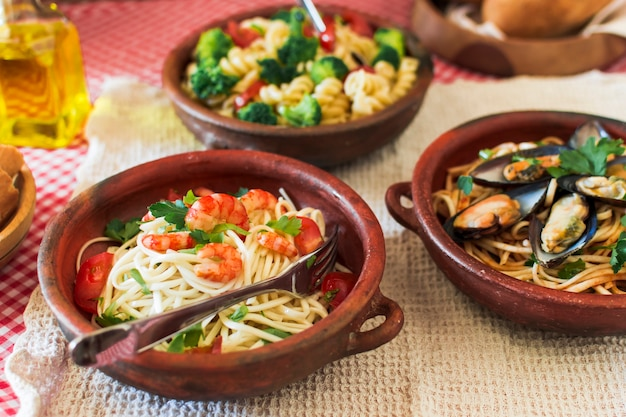 Close-up of several pastas on table
