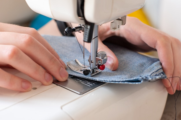 Close-up of sewing on denim sewing machine