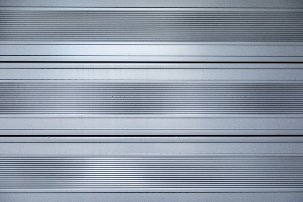 Close-up of shiny metal surface with horizontal stripes