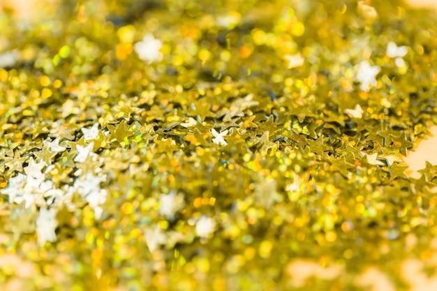 Close-up shiny star-shaped confetti