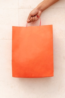 Close-up shopping bag holding by hand