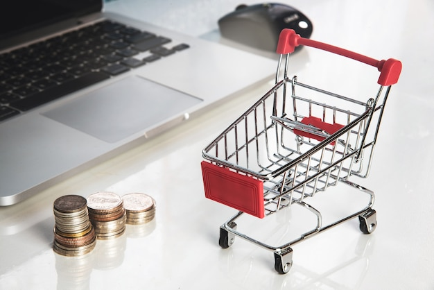 Close up shopping cart or supermarket trolley e-commerce and online shopping concept.