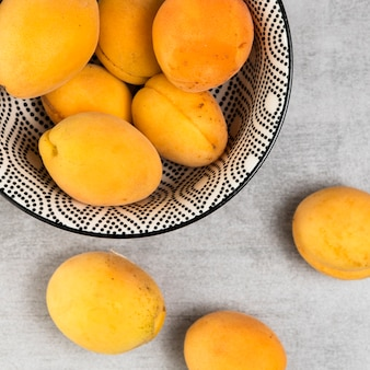 Close-up shot of apricots on wooden background