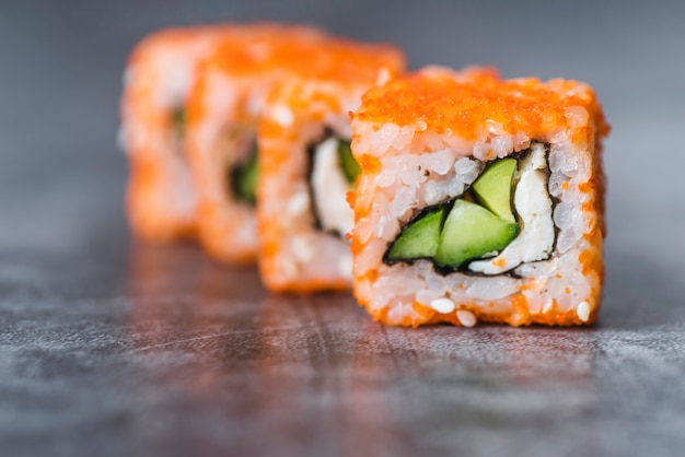 Close-up shot of arranged sushi rolls