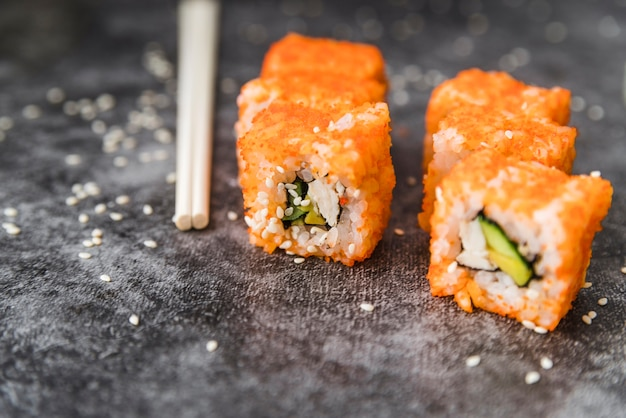 Close-up shot of arranged sushi with sesame seeds