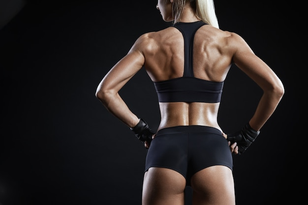 Close-up shot of back of female fitness model