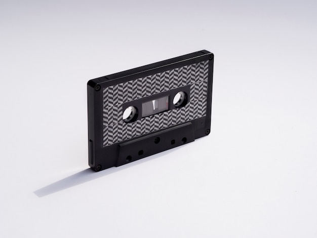 Close-up shot black cassette tape with shadow