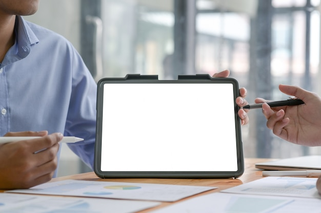Close up shot of business team using modern blank screen tablet