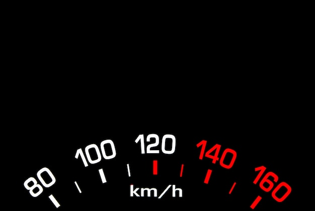 Close up shot of a car speedometer isolated on black background