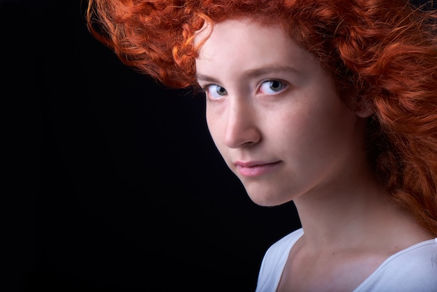 Close up shot of caucasian red haired girl with freckles