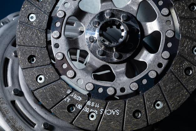 Close-up shot of clutch disk and basket on dark background