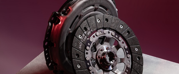 Close-up shot of clutch disk and basket on dark background