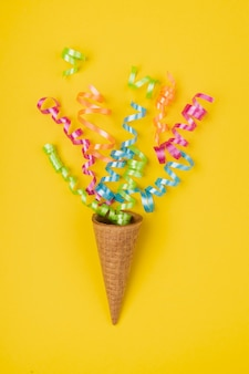 Close up shot confetti popping out of ice-cream cone