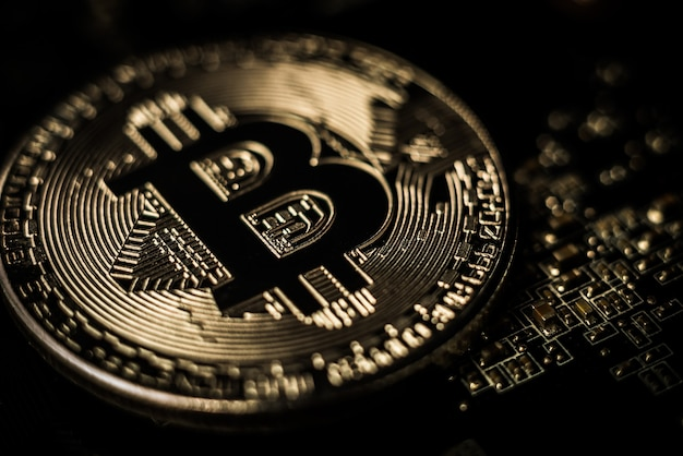 Close-up shot of copper bitcoin coin. cryptocurrency virtual money concept