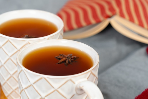 Close up shot of a cups of tea on wooden board at a christmas interior