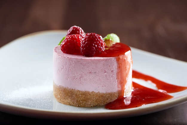 Close up shot of a delicious raspberry cheesecake decorated with raspberries copyspace cafe coffee shop restaurant confectionery bakery cooking pastry dessert sweets candy buffet.