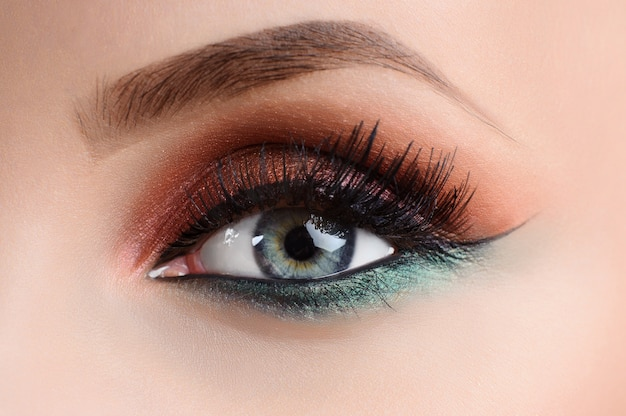 Close up shot of an eye of a female model with professional colo