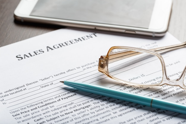 Close up shot of eyeglasses  on contract document papers business