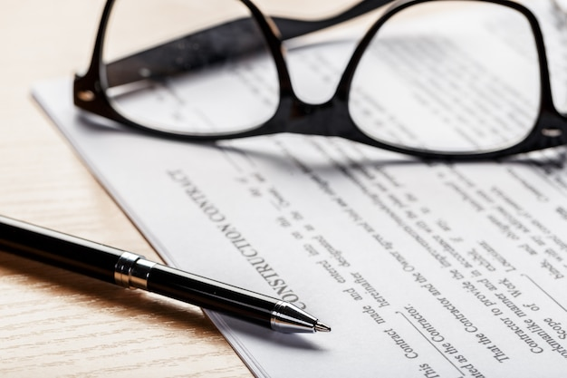 Close up shot of eyeglasses  on document papers