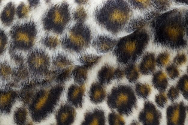 Close up shot of fake leopard tiger fur texture background