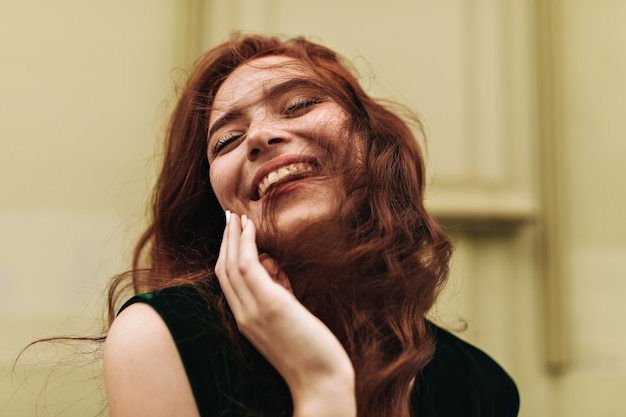 Close up shot of ginger woman laughing outside