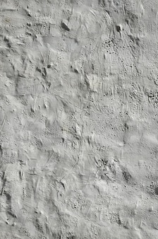 Close up shot of grunge brown clay wall on a old house.