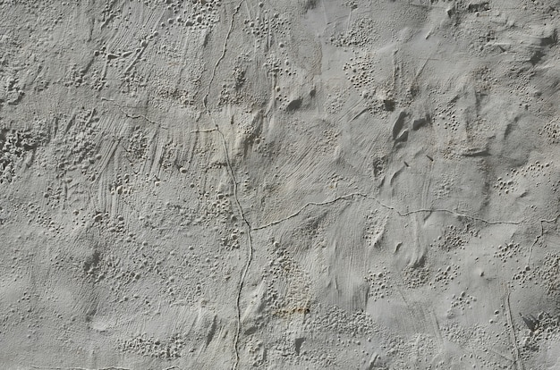 Close up shot of grunge brown clay wall on a old house