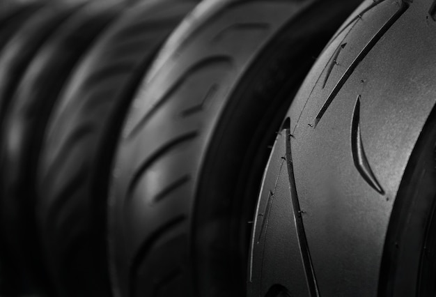 Close up shot of motorcycle tires on rack store in dark tone