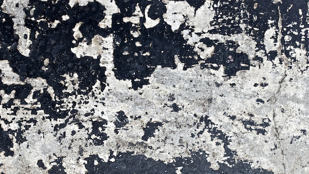 Закройте вверх по съемке старой черной предпосылки текстуры поверхности стены
