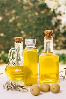 Close-up shot olive oil bottles in sunlight