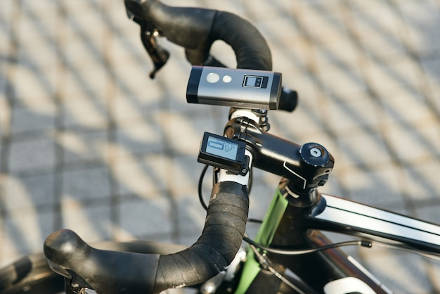 Close up shot of professional bike handlebar with equipment and accessories