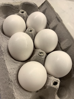 Close up shot of six eggs in an egg carton box