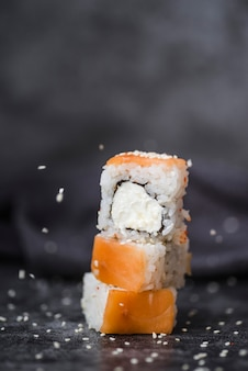 Close-up shot of stacked up sushi rolls