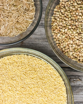 Close up shot of various types of  fresh grains in small glass bowls