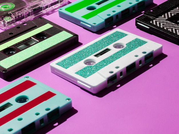 Close-up shot vibrant cassette tapes on pink background